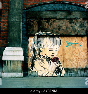 Street art in London's Smithfield by the American artist Shepard Fairey - Stock Photo