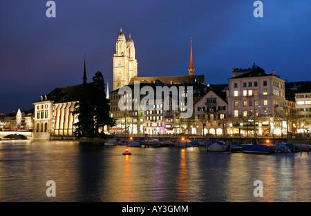 Limmat River and Grossmünster at night Zürich Switzerland - Stock Photo