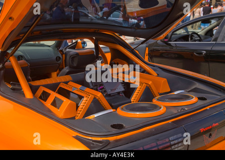 Car enthusiasts at show at Daytona Beach of modified cars with large stereo car system - Stock Photo