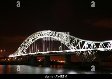 Runcorn Bridge (Silver Jubilee Suspension Bridge) at Night  [A533 Queensway, Runcorn/Widnes, Cheshire, England, - Stock Photo