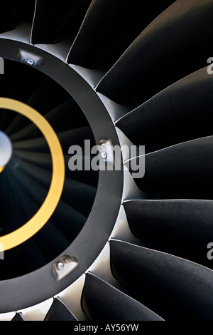 Closeup of the air inlet of an IAE V2500 turbofan engine showing the metal texture on the fan blades. - Stock Photo