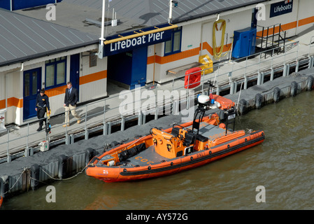 Rescue RIB moored at the RNLI Lifeboat Pier on the River Thames, Victoria Embankment, London, England - Stock Photo