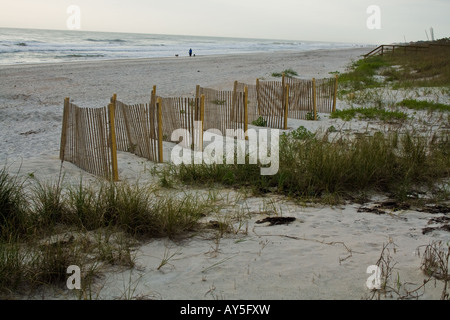 Wooden fence on the beach near Sea Oats by the ocean in Jacksonville Beach, Florida, USA - Stock Photo