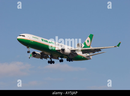 Eva Air Cargo McDonnell Douglas MD11F landing at London Heathrow airport. - Stock Photo