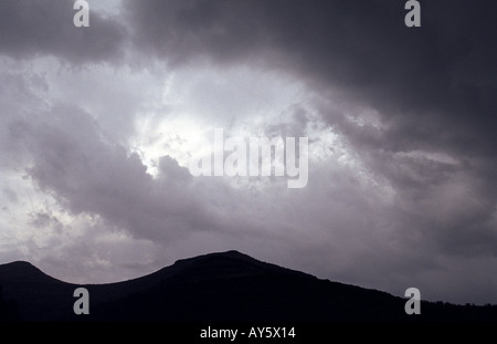Scene of dramatic violent dark thunder storm clouds swirling over mountain backgrounds climate - Stock Photo