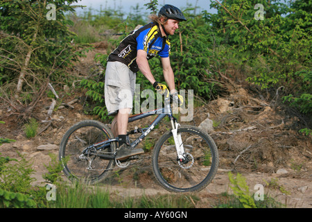 A mountain biker rides his mountain bike along a trail - Stock Photo