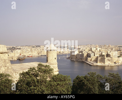 View over the Grand Harbour Venetian fortifications around harbour Coastline - Stock Photo