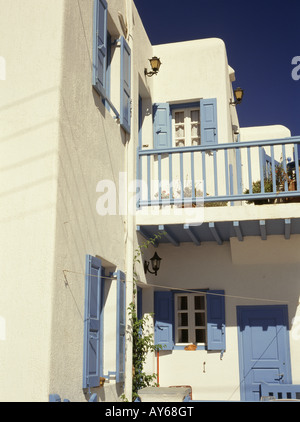 Cyclades Islands House White walls Blue painted woodwork shutters Balcony - Stock Photo