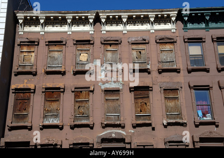 Brownstones under renovation on West 126th street in Harlem in NYC - Stock Photo