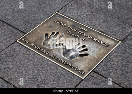 Hand prints of Sir Richard Attenborough in pavement Leicester Square London - Stock Photo
