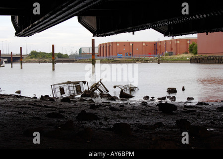 shopping trolleys in the river at Grimsby, UK - Stock Photo
