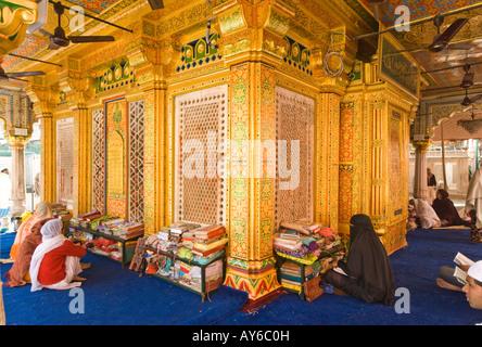 People pray at the Hazrat Nizamuddin Auliya Dargah mosque in Delhi in India - Stock Photo