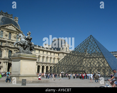 Place du Carrousel with Louvre Pyramid Paris square - Stock Photo