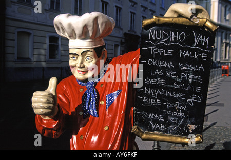 Life size model chef advertising a menu in the Old Town of Ljubljana Slovenia - Stock Photo