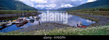 Moored sailing boats and canoeing and water sports in summer on Loch Leven, Glencoe, Highlands, Scotland, UK - Stock Photo