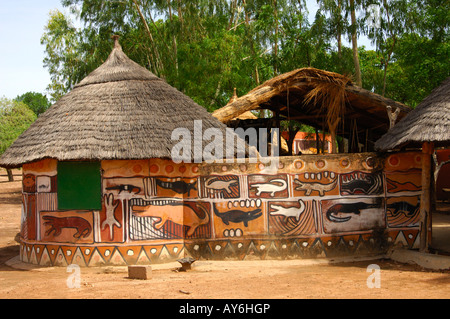 Symbolic mural paintings of crocodils at a wall of a hut in the village of saint crocodiles Bazoule Burkina Faso - Stock Photo
