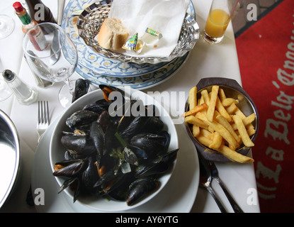 Typical mussels and chips meal in Brussels restaurant - Stock Photo
