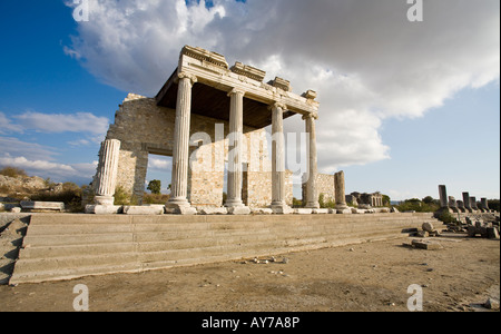 Ionic Stoa with Sky The partially rebuilt remains of the columned stoa surrounding a ruined temple in this Ionian - Stock Photo