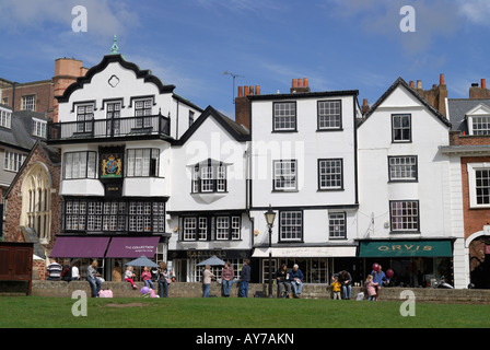View of historic buildings on Cathedral Yard in Exeter, England, on a sunny spring day - Stock Photo