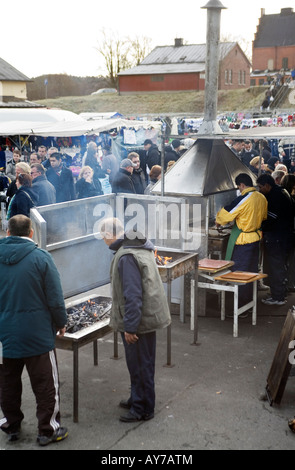 Barbecue kiosk on market square Weekend marketplace mostly run and visited by immigrant community in Kviberg Gothenburg - Stock Photo