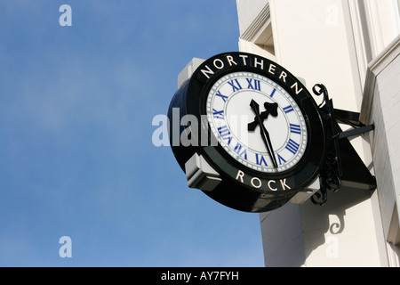 Clock bearing the name of Northern Rock above a branch of the building society (on Northumberland Street Newcastle. - Stock Photo