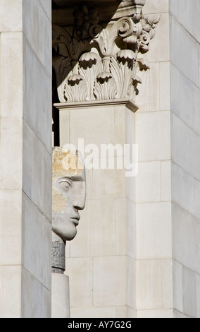 Sculpted heads by Emily Young 2003 facing St Paul's Cathedral London. - Stock Photo