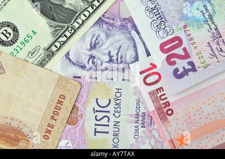 Mix of currency notes - US Dollar, European Euro British Pounds Sterling, Czech Korunas, Egyptian Pound - Stock Photo