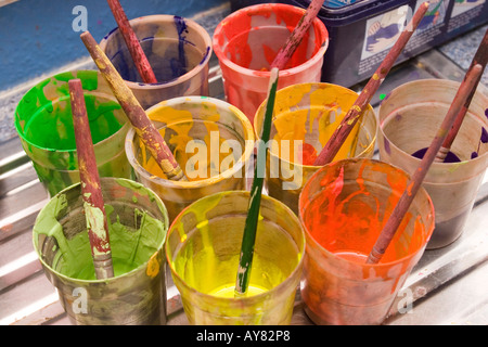 education nursery school coloured paint in pots - Stock Photo