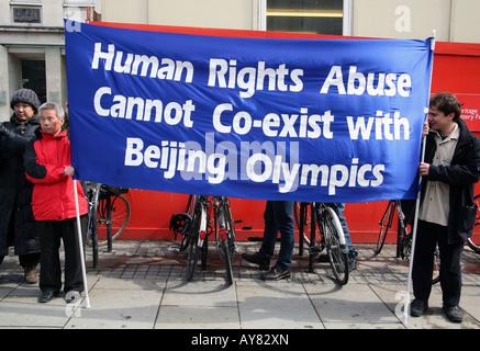 Anti-China protestors at London Olympic torch relay - Stock Photo