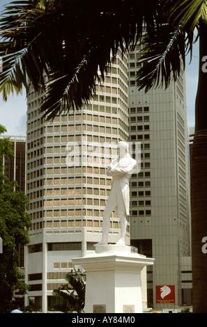 Singapore Statue of Sir Stamford Raffles on North Boat Quay - Stock Photo