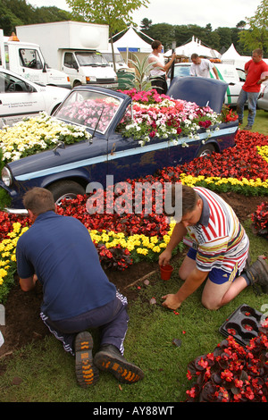 UK Cheshire Knutsford Tatton Hall RHA Flower Show Vale Royal staff prepare their bed abandoned car feature