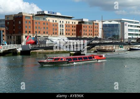 River Liffey Tourist Cruise Boat Passing Dublin City Mooring - Stock Photo