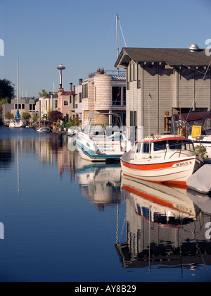 Houseboat community on east side of Lake Union with Space Needle in distance Seattle Washington - Stock Photo