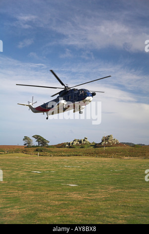 Isles of Scilly helicopter Sikorsky 61 over Tresco Heliport Scillies - Stock Photo
