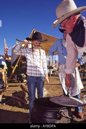 Pioneer cast-iron cooking gets the taste-test from Cheyenne Genest, at the Cowboy Symposium in Ruidoso Downs, New - Stock Photo