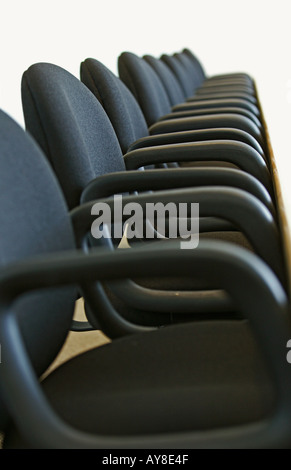 high rise office chairs. empty row of chairs in conference room at highrise office building - stock photo high rise