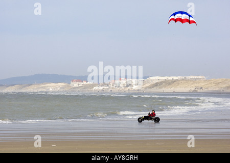 Kite Buggying on a beach - Stock Photo