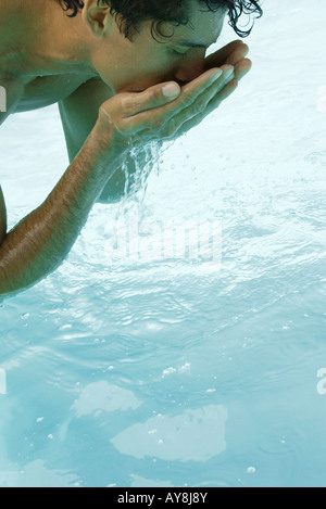 Close up of the hands of a man bending a bonsai tree wrapped in stock photo royalty free image How to make swimming pool water drinkable