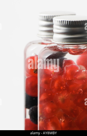 Fresh fruit in cosmetic bottles - Stock Photo