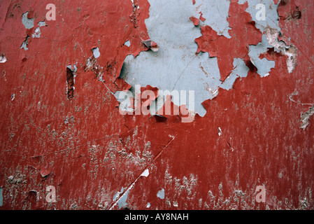 Peeling red paint, extreme close-up, full frame - Stock Photo