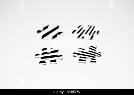Striped jigsaw puzzle pieces, close-up - Stock Photo