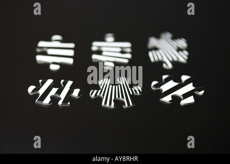 Jigsaw puzzle pieces, close-up - Stock Photo