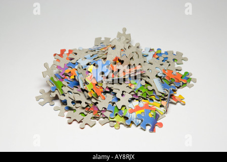 Jigsaw puzzle pieces in a pile, close-up - Stock Photo