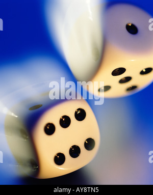 Close up of two rolling dice - Stock Photo