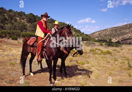 Riders pay their last respects to James W Bell, killed by Billy the Kid, in White Oaks, New Mexico. - Stock Photo