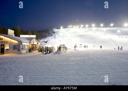 PEOPLE SKIING AT NIGHT, LEVI FINLAND - Stock Photo