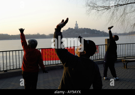 People exercise in the morning at Beihai Park in Beijing, China. 17-Feb-2008 - Stock Photo