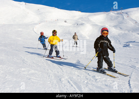 Childrens skiing lesson, Passo de Gardena, Selva Gardena, Italy - Stock Photo