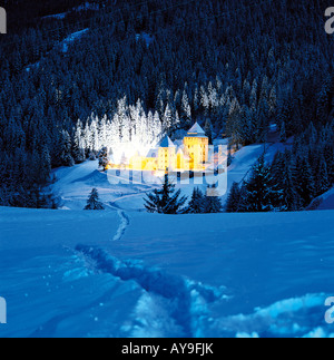 Fairytale castle in woodland, Passo de Gardena, Selva Gardena, Italy - Stock Photo