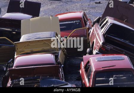 vehicles in scrapyard uk - Stock Photo
